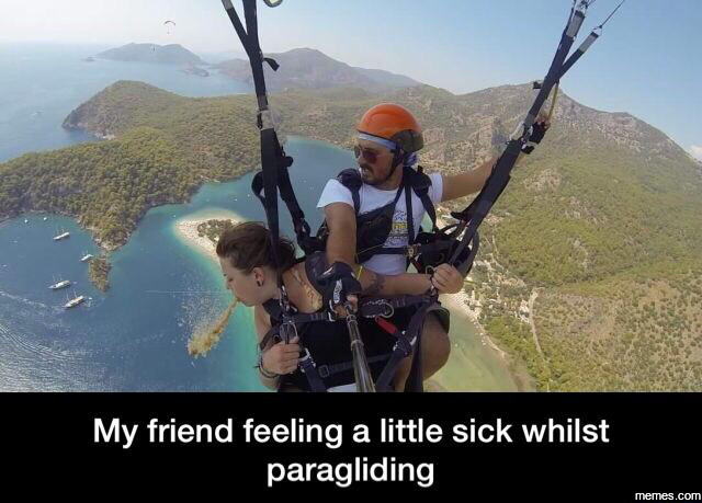 Feeling a little sick while paragliding | Memes.com